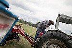 May 22, 2010. Baskerville, Virginia.. John Boyd, Jr. adds oil to a tractor on land that he and his father lease over 20 miles from their family farm to run cattle on, as they are unable to find land closer to home.. Dr. John Boyd, Jr., a Virginia farmer, has lobbied the White House and Congress for the better part of two decades on behalf of black farmers. .A $1.25 billion settlement he helped to negotiate in February for the federal government to compensate black farmers has become ensnared in Washington. .Meanwhile, many elderly farmers who stand to benefit are dying before they can seek restitution..Their case, known as the black farmers settlement, and commonly referred to as Pigford II, is the second phase of a federal lawsuit settled in 1999. It covers more than 80,000 farmers who claim they were denied critical aid comparable to what white farmers received from the Department of Agriculture between 1981 and 1996 because of the color of their skin..Congress reopened the case in 2008, and set aside $100 million to address the late claims. President Barack Obama, who co-sponsored the 2008 measure when he was in the Senate, created a $1.15 billion line item in his budget for the 2010 fiscal year to cover the new class of litigants..The money was less than half of the $2.5 billion the farmers had fought for, but the administration's promise of a quick resolution prompted them to accept the deal.  .