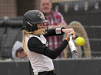 NWA Democrat-Gazette/BEN GOFF @NWABENGOFF<br /> Tymber Riley, Bentonville second baseman, flies out to left field Thursday, March 16, 2017, during the softball game at Bentonville's Tiger Athletic Complex.