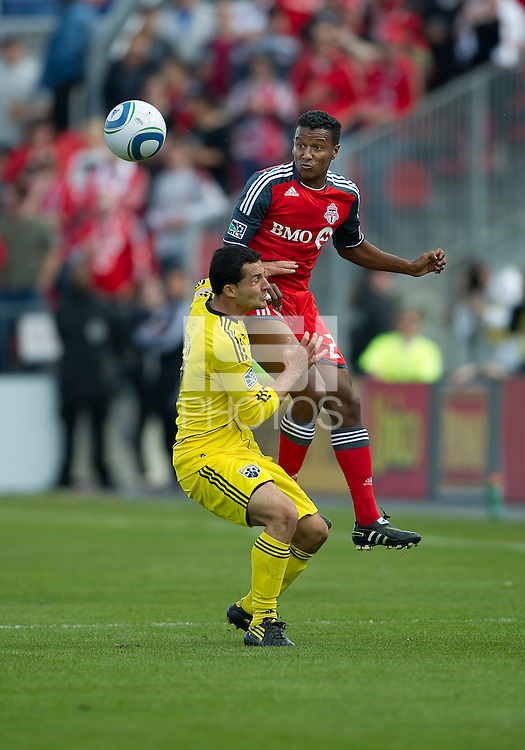 23 April 2011: Columbus Crew midfielder Dilly Duka #11 and Toronto FC defender Danleigh Borman #25 in action during a game between the Columbus Crew and the Toronto FC at BMO Field in Toronto, Ontario Canada..The game ended in a 1-1 draw.