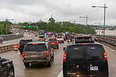 A motorcade carrying United States President Donald J. Trump navigates rush hour traffic in Washington, DC as it returns to the White House following Trump's visit to see first lady Melania Trump at Walter Reed Medical Center in Bethesda, Maryland on May 16, 2018.  <br /> Credit: Alex Edelman / Pool via CNP