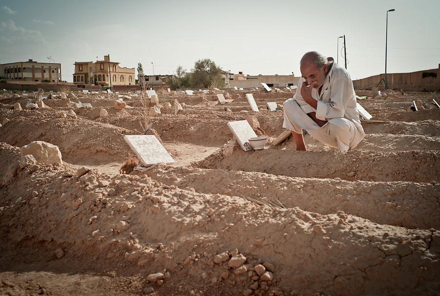 Libyan man mourns at cemetary in Zintan, Libya