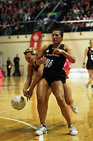 World captain Natasha Chokljat and Liana Barrett-Chase compete for the ball during the International  Netball Series match between the NZ Silver Ferns and World 7 at TSB Bank Arena, Wellington, New Zealand on Monday, 24 August 2009. Photo: Dave Lintott / lintottphoto.co.nz