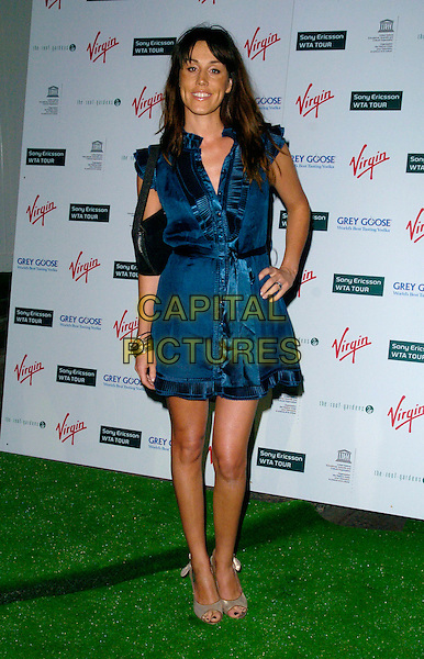 LUCY RUSEDSKI .At a Sony Ericsson WTA Tour Pre-Wimbledon Party, The Roof Gardens, Kensington, London, England,.June 21st, 2007.full length blue teal  sleeveless wrap dress belt sash hand on hip black bag gold peep-toe shoes.CAP/CAN.©Can Nguyen/Capital Pictures