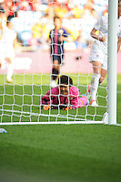 25.07.2012 Coventry, England. Miho FUKUMOTO (Japan) watches as Canada's goal bound shot goes in for their equaliser during the Olympic Football Women's Preliminary game between Japan and Canada from the City of Coventry Stadium