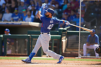 Edwin Rios (43) of the Los Angeles Dodgers follows through on a swing during a Cactus League Spring Training game against the Texas Rangers on March 8, 2020 at Surprise Stadium in Surprise, Arizona. Rangers defeated the Dodgers 9-8. (Tracy Proffitt/Four Seam Images)