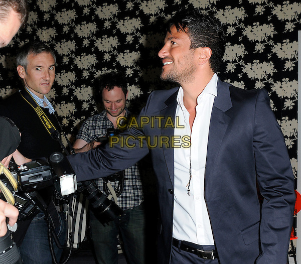 "PETER ANDRE.Attending a photocall for ""Peter Andre: The Next Chapter"" at Soho Hotel, London, England, UK, April 26th 2011..half length grey gray suit white shirt  belt shaking hands with photographers press photographer  profile smiling .CAP/CAN.©Can Nguyen/Capital Pictures."
