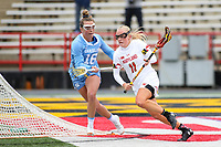 College Park, MD - February 24, 2019: Maryland Terrapins attack Caroline Steele (11) tries to run past North Carolina Tar Heels Catie Woodruff (16) during the game between North Carolina and Maryland at  Capital One Field at Maryland Stadium in College Park, MD.  (Photo by Elliott Brown/Media Images International)