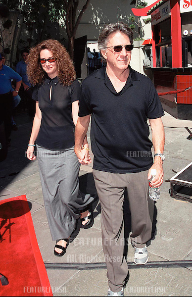 30SEP99:  Actor DUSTIN HOFFMAN & wife at Mann's Chinese Theatre in Hollywood where Warner Bros. chairmen & co-CEOs ROBERT A. DALY & TERRY SEMELhad their hand & footprints set in cement..© Paul Smith / Featureflash