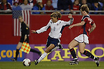 01 October 2003: The United States' Mia Hamm (9) pushes past Norway's Brit Sandaune (2). The United States defeated Norway 1-0 at Gillette Stadium in Foxborough, Massachusetts in a 2003 Women's World Cup quarterfinal game..This photo is the basis of the Womens Professional Soccer's (WPS) league logo.