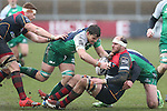 Connacht pair Danie Poolman and Jake Heenan haul down Dragons lock Rynard Landman.<br /> Guiness Pro12<br /> Gwent Dragons v Connacht<br /> Rodney Parade<br /> 22.02.15<br /> ©Steve Pope -SPORTINGWALES