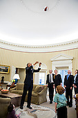 United States President Barack Obama throws a basketball in the air during departure photos with Samantha Power, Senior Director for Multilateral Affairs and Human Rights, and her family in the Oval Office, Feb. 22, 2013. Watching the President, from left, are: Rian Power-Sunstein, Cass Sunstein, Samatha Power, Declan Sunstein, James Bourke, and Veronica Delany. .Mandatory Credit: Pete Souza - White House via CNP