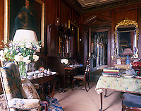 An antique bureau occupies one corner of the wood panelled drawing room