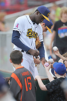 Burlington Bees pitcher Samil De Los Santos (46) gives his autograph to young fans prior to a game against the South Bend Cubs at Community Field on May 10, 2017 in Burlington, Iowa.  The Bees won 4-3 in 10 innings.  (Dennis Hubbard/Four Seam Images)