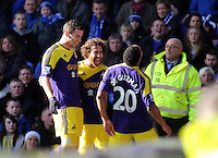 Pictured: Jonathan de Guzman of Swansea (R) with team mates Alvaro Vazquez and Jose Canas celebrating his equaliser making the score 1-1. Sunday 16 February 2014<br />