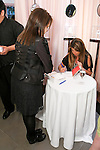 "Nina Garcia's autographs a book for fan during the Nina Garcia's ""Look Book: What To Wear For Every Occasion"", book release party with Marie Claire at Tous Rockefeller Center, August 17, 2010."