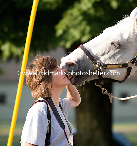 Photographer Barbara Livingston nuzzles Poncho, Steve Asmussen's stable pony