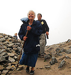 Rosaleen Gartland smiling on the summit of Croagh Patrick, the 85 years young lady from Banbridge was one of many thousands who took part in the pilgrimage on Ireland holy mountain yesterday...Pic Conor McKeown