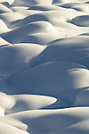 Large rocks covered in deep snow create an abstract scene in Jasper National Park, Alberta Canada, on Feb 1, 2011.  Photo by Gus Curtis