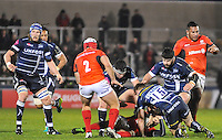 Sale Sharks No15 Mike Haley Tackles Saracens No 13 Marcelo Bosch during the European Rugby Champions Cup match between Sale Sharks and Saracens at AJ Bell Stadium, Salford, England on 18 December 2016. Photo by Paul Bell.