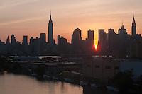 New York, NY -  30 May 2011 Manhattanhenge viewed from Newtown Creek.