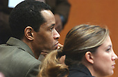 Sniper suspect John Allen Muhammad, left, listens to testimony along with defense attorney Christie Leary, during his trial in courtroom 10 at the Virginia Beach Circuit Court in Virginia Beach, Virginia on October 28, 2003. <br /> Credit: Adrin Snider - Pool via CNP