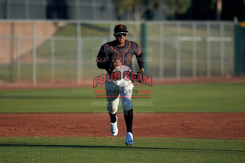 AZL Giants Black third baseman Jose Rivero (2) jogs off the field between innings of an Arizona League game against the AZL Angels at the Giants Baseball Complex on June 21, 2019 in Scottsdale, Arizona. AZL Angels defeated AZL Giants Black 6-3. (Zachary Lucy/Four Seam Images)