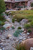 Dry creek rainwater bioswale for water permeability in Schaff Garden; Carpinteria California