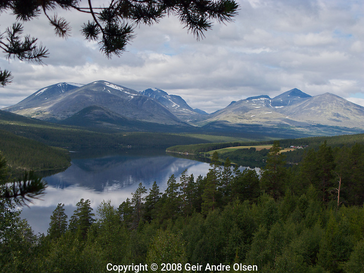The mountain range Rondane viewed from Solhberg´s place in Folldal, Norway. This is the site where the famous painter Harald Sohlberg painted his picture Winters night in Rondane in 1901. We can see The three major peaks Storronden, Rondeslottet and Høgronden.