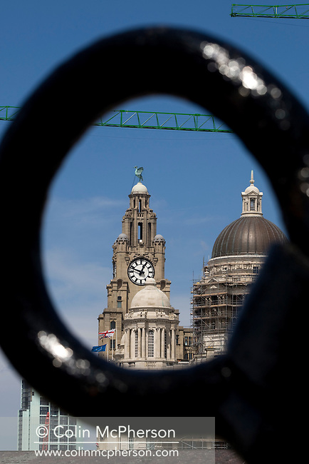 The Liver Building with its distinctive Liver Bird on one of the towers, and the former offices of the Mersey Docks and Harbour Board clad in scaffolding framed viewed from the Albert Dock through the loop of a ship's anchor. The city centre of Liverpool underwent significant regeneration with a number of large-scale projects due to be completed in 2008-08. In 2007 the city celebrated its 800th anniversary and in 2008 it held the European Capital of Culture title together with Stavanger, Norway.