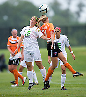 Samantha Huecker (21) of the Charlotte Lady Eagles goes up for a header with Molly Bruh (19) of the Long Island Rough Riders during the game at the Maryland SoccerPlex in Boyds, Maryland.  The Charlotte Lady eagles defeated the Long Island Rough Riders, 4-0, to advance to the W-League Eastern Conference Championship.