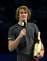 Alexander Zverev giving his victory speech with his bottle of champagne <br /> <br /> Photographer Hannah Fountain/CameraSport<br /> <br /> International Tennis - Nitto ATP World Tour Finals Day 7 - O2 Arena - London - Saturday 17th November 2018<br /> <br /> World Copyright &copy; 2018 CameraSport. All rights reserved. 43 Linden Ave. Countesthorpe. Leicester. England. LE8 5PG - Tel: +44 (0) 116 277 4147 - admin@camerasport.com - www.camerasport.com