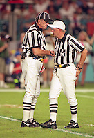 Officials discuss a call as the Jets defeated the Dolphins 20-3 in Miami , FL on November 19, 2000. (Photo by Brian Cleary / www.bcpix.com)