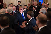 United States President Donald J. Trump shakes hands with governors after addressing the 2019 White House Business Session at the White House in Washington, D.C. on February 25, 2019. Trump discusses the group on infrastructure, the opioid epidemic, border security and China trade policy. <br /> Credit: Kevin Dietsch / Pool via CNP