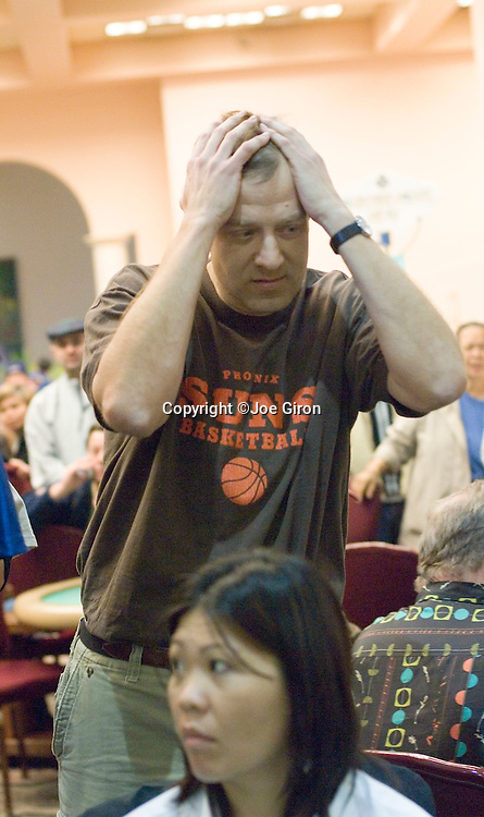"""Bob Slezak reacts to losing a big hand to Randy Gil.  Gil gets a 2 on the turn for trip """"2's"""" to Slezak's pocket queens."""