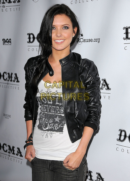 AUDRINA PARTRIDGE .at The DCMA Collective Grand Opening of the Flagship Store in West Hollywood, California, USA,  March 14th 2008.                                                                     .half length black  leather jacket jeans.CAP/DVS.©Debbie VanStory/Capital Pictures