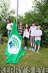 Green Flag - Scoil Nuachabhall, Ballymacelligot win their 5th flag, and invited local Mountain running champion John Lenihan to raise the flag on Monday. Pictured with john are Green Flag Committee Niamh Rahilly, Chairperson, Eve Creedon, Secretary, Eoin Culloty, Recording Secretary, Ciaran Brosnan, Vice Chairperson of