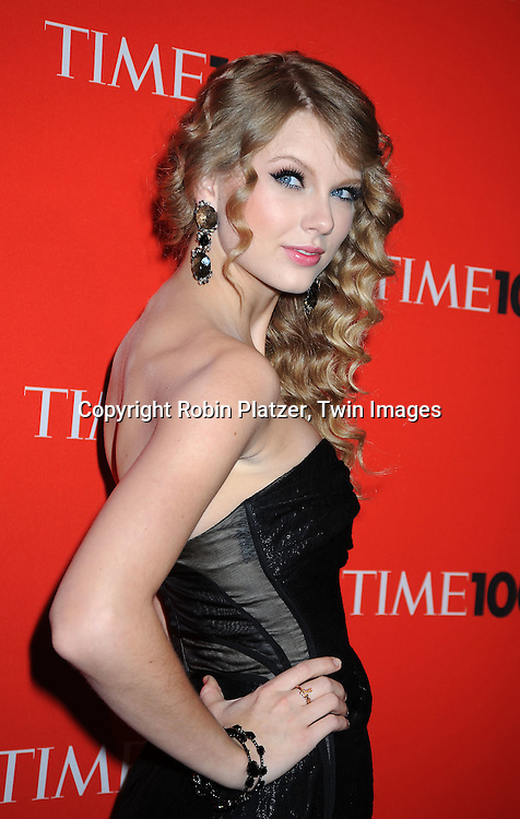 Taylor Swift posing for photographers at the Time Celebrates the Time100 Issue Gala on May 4, 2010 at The Time Warner Center in New York City. The magazine celebrates the 100 Most Influential People in the World.
