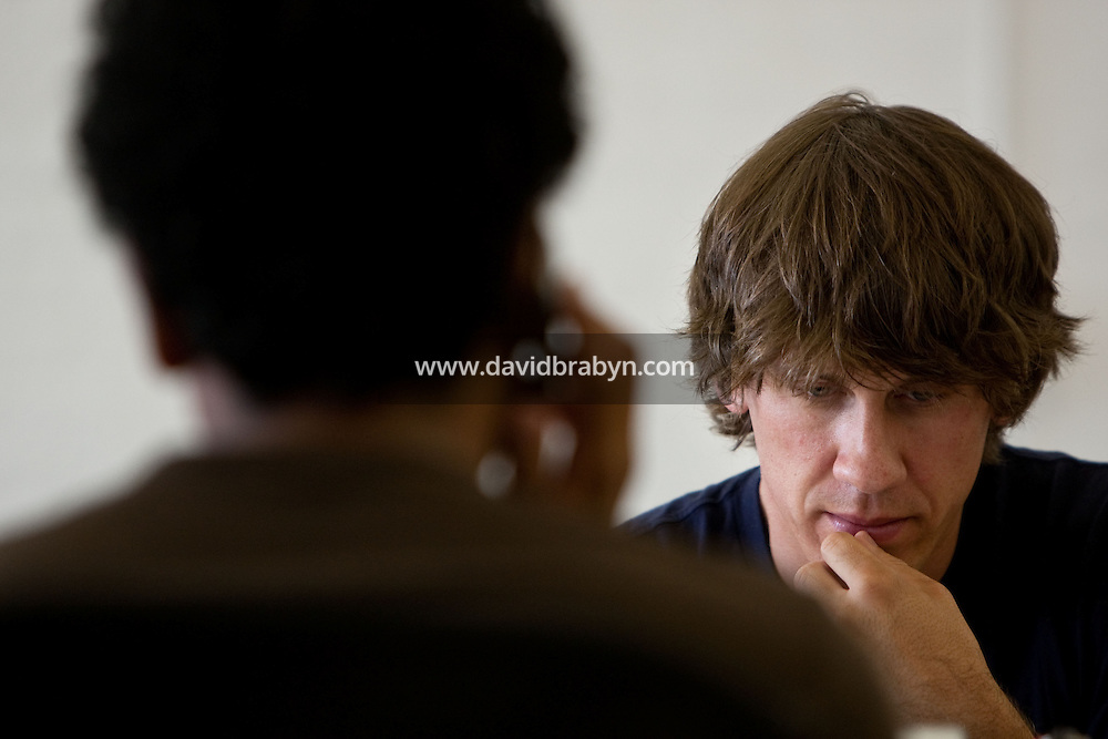 """Dennis Crowley (R) and Naveen Selvadurai, co-founders of social media website Foursquare, work at their desks in their shared office in New York, USA, 5 August 2009. Foursquare, which allows users to stay connected to friends and explore a city, has been dubbed """"the next Twitter"""" by an influential tech blog."""