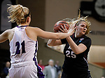 SIOUX FALLS, SD: MARCH 19: Maura D'Anna #25 of Indiana (PA) looks past Stonehill defender Samantha Hyslip #21 during their game at the 2018 Division II Women's Elite 8 Basketball Championship at the Sanford Pentagon in Sioux Falls, S.D. (Photo by Dick Carlson/Inertia)