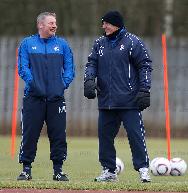 Walter Smith telling a story to Ally McCoist at training