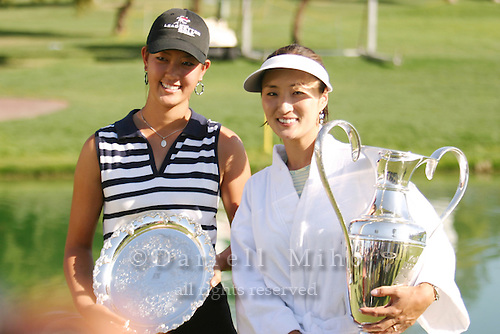 March 28, 2004; Rancho Mirage, CA, USA;  Tournament winner Grace Park poses with low amateur winner Michelle Wie after the final round of the LPGA Kraft Nabisco golf tournament held at Mission Hills Country Club.  Park won her first major tournament by one stroke over Aree Song with an overall score of 11 under par 277.  She finished the day with a 3 under par 69.  Wie finished at 7 under par (281) and 4th place overall.<br />Mandatory Credit: Photo by Darrell Miho <br />&copy; Copyright Darrell Miho