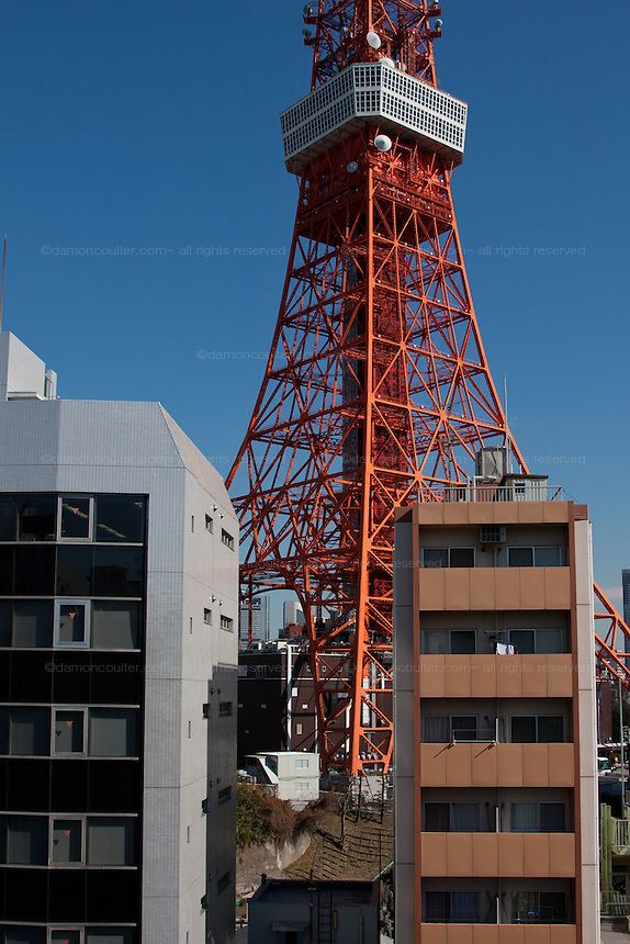 Tokyo Tower behind apartment buildings in Tokyo, Japan. Friday February 3rd 2012