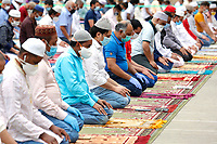Prayer in Giordano Sangalli park, in the heart of Torpignattara, where many Bengali people live <br /> Roma May 24th 2020. Big prayer for the end of Ramadan, and first day of Eid al-Fitr. In occasion pf the end of muslim holy month of Ramadan, faithfuls gathered in many squares of Rome, maintaining the social distancing, for the first public prayer lockdown due to the coronavirus pandemic. Everywhere, at the entrance of the places of prayer, people were taken the temperature, and a bag to put their shoes in. No people were allowed without mask.<br /> Photo Samantha Zucchi Insidefoto