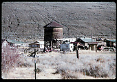Water tank surrounded by small buildings and houses. Location unknown.<br /> D&amp;RGW