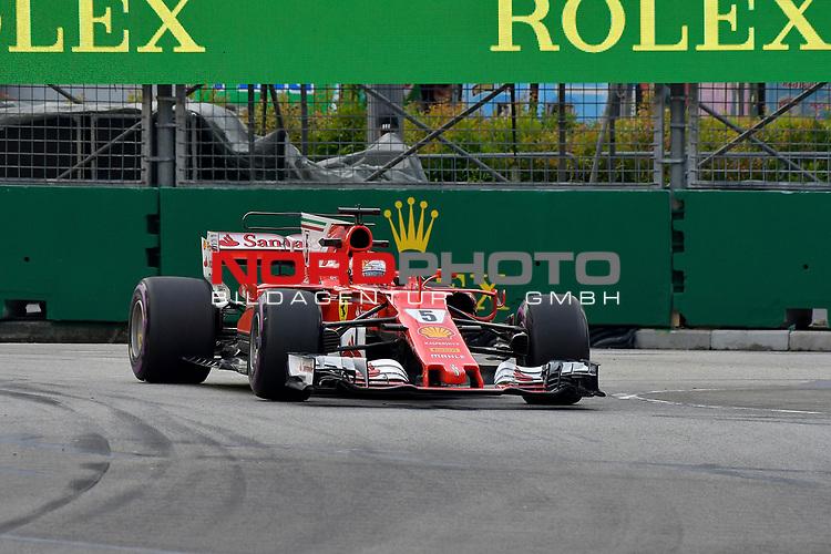 15.09.2017, Marina Bay Street Circuit, Singapore, 2017 FORMULA 1 SINGAPORE AIRLINES SINGAPORE GRAND PRIX , 15. - 17.09.2017<br />   , im Bild<br /> Sebastian Vettel (GER#5), Scuderia Ferrari<br /> <br />  <br /> <br /> Foto &copy; nordphoto / Bratic