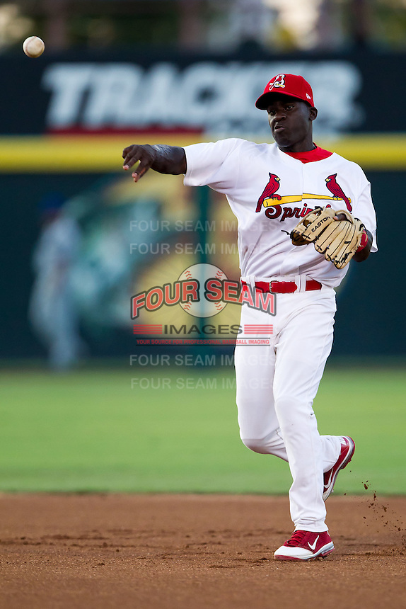 Jermaine Curtis (5) of the Springfield Cardinals throws to first during a game against the Tulsa Drillers at Hammons Field on July 19, 2011 in Springfield, Missouri. Tulsa defeated Springfield 17-11. (David Welker / Four Seam Images)