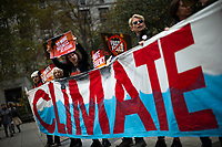NEW YORK, USA - October 22: People shout slogans agains Exxon as they take part in a protest against ExxonMobil before the start of its trial outside the New York State Supreme Court building on October 22, 2019 in New York, USA. the trial will establish whether Exxon Mobil, the country's largest fossil fuel company, lied to investors about the cost of carbon emissions to its business. (Photo by Eduardo MunozAlvarez/VIEWpress)