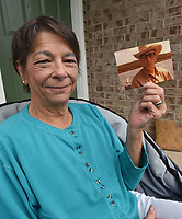 NWA Democrat-Gazette/FLIP PUTTHOFF <br />Joy Long, winner of the 2017 Northwest Arkansas Democrat-Gazette fish story contest, shows a picture of her late father, Dr. Ross Bizzell. Her championship story tells of a father-daughter fishing trip.