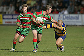 P Baird tries to elude the clutches o f.B Maloney. Counties Manukau Premier Club Rugby, Waiuku vs Patumahoe played at Rugby Park, Waiuku on the 8th of April 2006. Waiuku won 18 - 15
