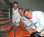 REPRO FREE PHOTO:   <br /> Brothers Fintan, Liam and Ronan Quinlan from <br /> Quinlan's Kerryfish  remove fresh smoke salmon from the same oven their father used 50 years ago at their smokery in Renard, Cahersiveen, County Kerry on Thursday as they celebrate winning two gold medals at the 2015 Great Taste Awards for their smoked salmon. Quinlan's Kerryfish are the only Salmon Smoker in Ireland and the UK to Scoop 3 stars in the awards and it's the second year in a row for Quinlan's Organic Smoked Irish Salmon to win a Great Taste Award.<br /> Photo: Don MacMonagle<br /> <br /> PRESS RELEASE<br /> Quinlan's Kerryfish is celebrating again after winning   two prestigious 3 star Great Taste Awards in the 2015 competition and being placed twice in the top 50 foods in the UK and Ireland.  Quinlan's Kerryfish are the only Salmon Smoker in Ireland and the UK to Scoop 3 stars in the awards and it's the second year in a row for Quinlan's Organic Smoked Irish Salmon to win a Great Taste Award.<br />